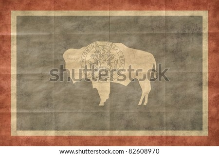 Shabby Wyoming flag, closeup background.