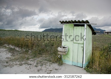 Shack in a field surrounding the Cotopaxi volcano covered with ashes after the volcano eruptions, Ecuador - stock photo