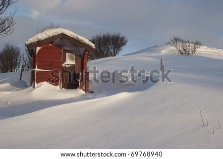 Shack in winter snow in Iceland - stock photo