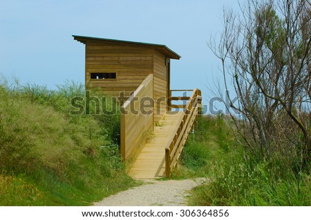 Shack to observe animals natural reserve park - stock photo