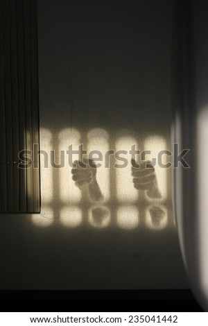 Shading both hands on the handle bars of dark leak fearful of the bedroom. artistic photo. Contrast, silhouette of hands figure on sunny day - stock photo