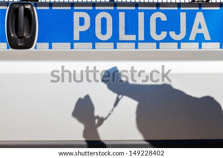 Shadow arrested criminals against the police car. - stock photo