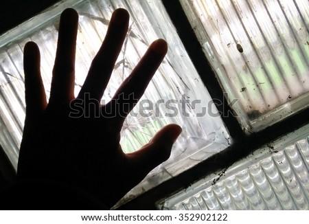 Shadow hand on mirror wall. - stock photo