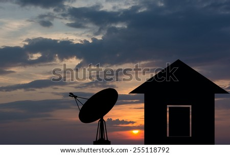Shadow home with a satellite dish - stock photo