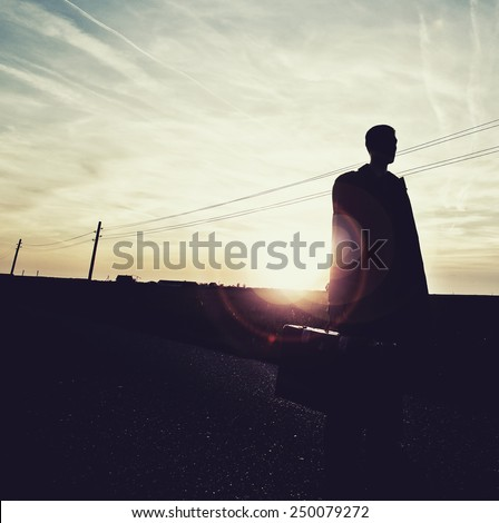 shadow man on empty road in sunset,lonely traveler , freedom concept,outsider,change life ,freedom of choice  - stock photo