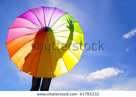 Shadow multicolor umbrella woman - stock photo
