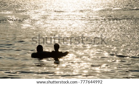 Shadow Of A Couple Playing In The Sea Presenting Holiday Ideas And Good Family