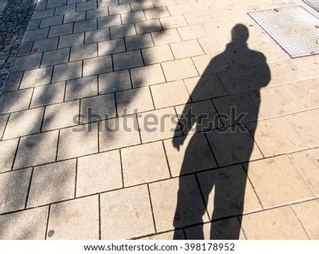 shadow of a man - stock photo