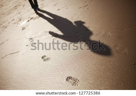Shadow of a man chasing me - stock photo