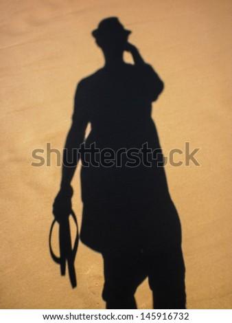 Shadow of a man on Bondi beach ,Sydney. - stock photo