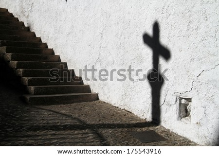 Shadow of a religious cross on the wall in Ronda, Spain.