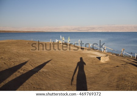 Shadow of a thirsty traveler at the Dead Sea