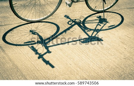 Shadow of bicycle in the sun with vintage effect