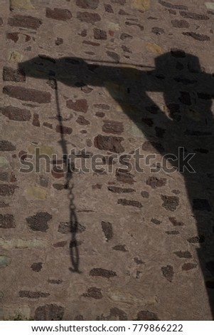 Shadow of Gallow at Cobblestone wall Castle in Germany