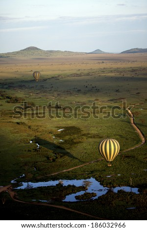 Shadow of Hot Air Balloon Serengeti Africa - stock photo
