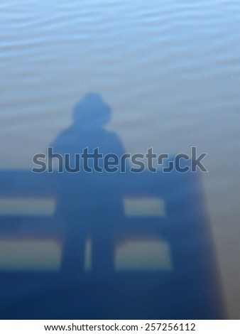 Shadow of Person in Water on Observation Deck - stock photo