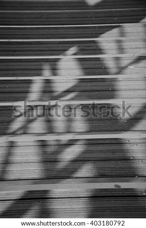 Shadow of railings on the bridge steps. Fragment of Solferino bridge over Seine River in Paris. Selective focus on central steps. - stock photo
