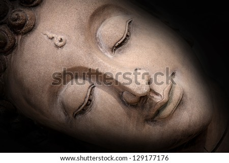 Shadow of the head Buddha - stock photo