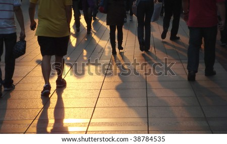 Shadows of people walking in a street of the city. - stock photo