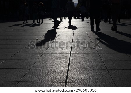 Shadows of people walking in a street of the city, Athens  - stock photo