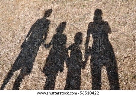 Shadows of the family - stock photo