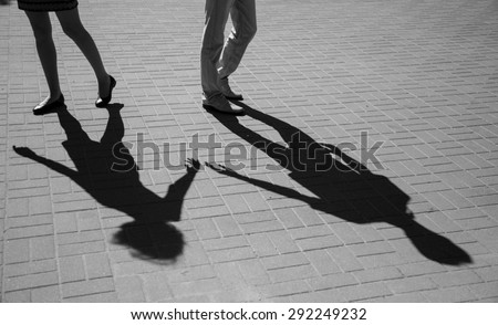 Shadows of two young people, love concept - stock photo