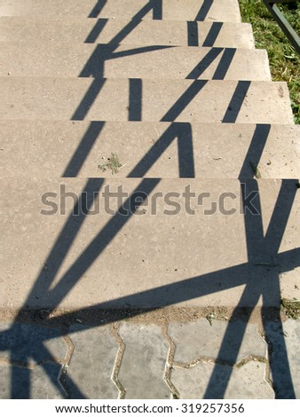 Shadows on a surface of concrete stairs