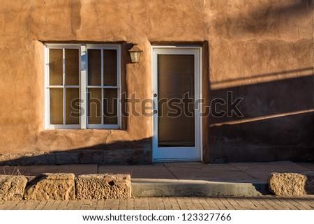 Shadows on an adobe wall in Santa Fe, New Mexico - stock photo