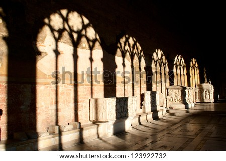 Shadows on the wall. Camposanto building in Pisa, Italy - stock photo