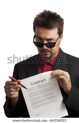 Shady and untrustworthy business man offering pen to sign a contract. Studioshot on white background - stock photo