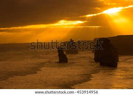 Shaft of lights make Silhouette of Twelve apostles at Great Ocean Road, Melbourne, Australia - stock photo