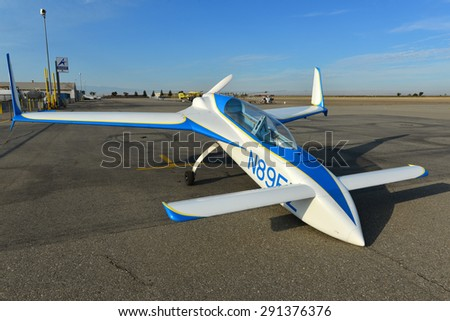 SHAFTER, CA - JUNE 27, 2015:  The local airport is visited by a VariEze, the famous homebuilt composite  aircraft, designed by Burt Rutan. Note the unusual canard layout (tail first). - stock photo