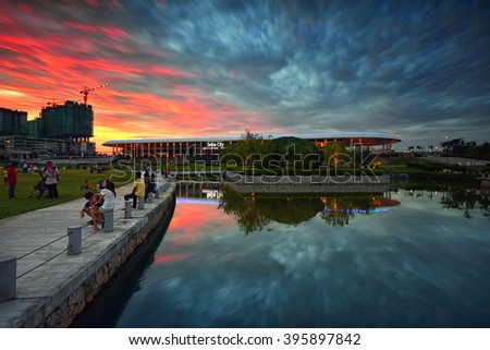 SHAH ALAM, MALAYSIA - MARCH 20, 2016 : Beautiful sunset with reflections of sky and building at Setia City Convention Centre, Setia Alam. Most well known place for visitors to relaxing and socializing. - stock photo