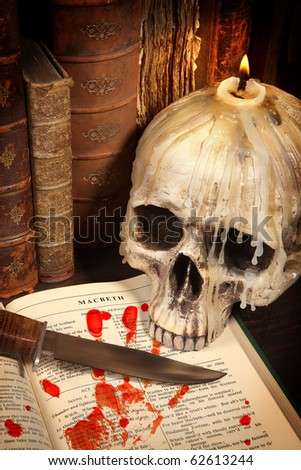 Shakespeare's Macbeth with old books and a dagger - stock photo