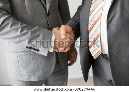 shaking hand of father and son - stock photo