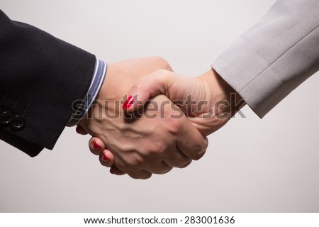 Shaking hands means to develop the specific skills in your career, which may provide you with unbelievable experience and interesting acquaintances with workers from different spheres. - stock photo