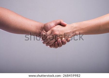 Shaking hands of two male people - stock photo