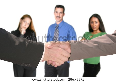 Shaking Hands With Business Team Looking on