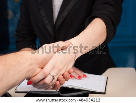 Shaking hands with client in office, closeup, conclusion, contract, concept business woman