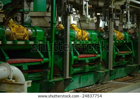 Shale Shakers on large scale oil rig - stock photo