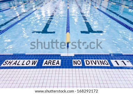 Shallow area of swimming pool, no diving - stock photo