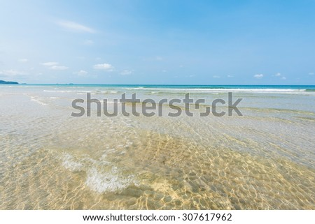 Shallow beach with clear and clean water at Koh Chang Island in Thailand - stock photo
