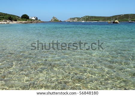 Shallow clear water between Bryher and Tresco, Isles of Scilly. - stock photo