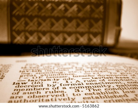 Shallow depth of field description of law and law textbooks - stock photo