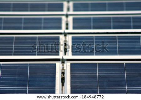 Shallow depth of field front focus of solar panels on the roof - stock photo