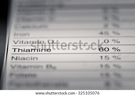 Shallow depth of Field image of Nutrition Facts Thiamine Information we can find on a grocery Store Product.
