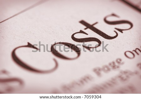 """Shallow depth of field with """"Costs"""" and paper texture in focus. - stock photo"""