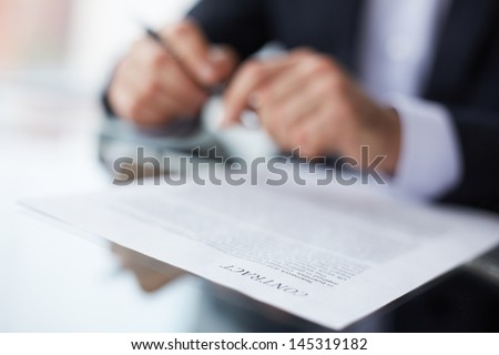 Shallow dof image of a businessman signing the contract - stock photo