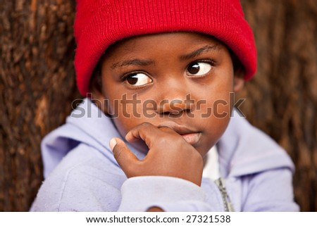 shallow DOF of african child , bark of tree background - stock photo
