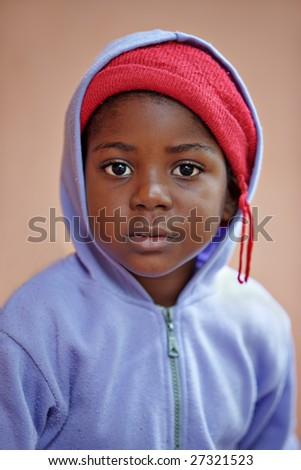 shallow DOF of african child casual dressed - stock photo